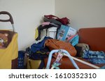 Small photo of Bangkok / Thailand - 12 23 2019: Over consumerist lifestyle. Unorganized messy home interior in a studio apartment in Thailand.