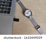 A Wristwatch  A Laptop  A...