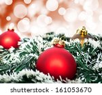 Red christmas ornament ball against red bokeh background - stock photo
