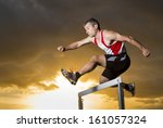 athlete in hurdling in track... | Shutterstock . vector #161057324