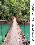 Small photo of Costa Rica. Drake Bay. Suspension bridge across the Rio Agujitas, part of the Drake Bay Hiking Trail.