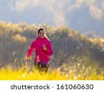 beautiful young woman running... | Shutterstock . vector #161060630
