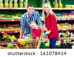 family shopping in grocery market - stock photo