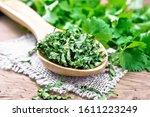 Dried Cilantro In A Spoon On...