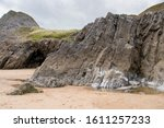 A Craggy Little Cave Opening In ...