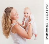 happy young mother and baby...   Shutterstock . vector #161151440