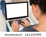 Stock photo close up of young woman using laptop on couch 161152490