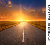 empty asphalt road at sunset | Shutterstock . vector #161156606