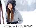 young woman winter portrait.... | Shutterstock . vector #161180003