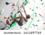 Sportive Man Climbing A Wall In ...