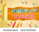 word writing text minimum wage. ... | Shutterstock . vector #1612102666