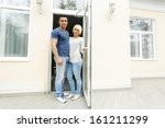 happy couple welcomes you in... | Shutterstock . vector #161211299