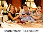 young friends with glasses of... | Shutterstock . vector #161230829