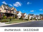 street of large suburban homes   Shutterstock . vector #161232668