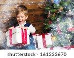 Little Boy Opening Gift Box...