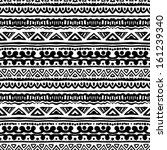 Ethnic pattern in black and white with ornamental stripes. Texture for web, print, wallpaper, home decor, summer fall fashion textile or fabric, website background, wrapping paper. - stock vector