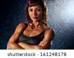 Young strong woman water portrait. - stock photo