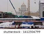 Small photo of MOSCOW, RUSSIA - JANUARY 11, 2020. Works are under way to convert the old power station and area into the Center of Modern Art (Italian architect Renzo Piano). Cathedral of Christ the Savior (center).