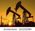 oil pump on orange sunset  | Shutterstock . vector #161252984