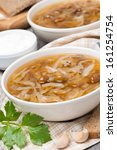 Small photo of traditional Russian cabbage soup (shchi) with mushrooms and garlic, vertical