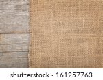 burlap texture on wooden table... | Shutterstock . vector #161257763