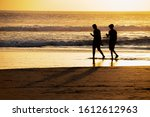 Silhouette Of A Two People On...