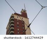 Torre Littoria skyscraper in Piazza Castello behind tramway wires in Turin, Italy