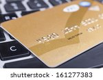 golden credit card close up on... | Shutterstock . vector #161277383