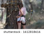 A Girl Is Doing A Climbing Tre...