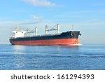 Large Cargo Ship Sailing In...