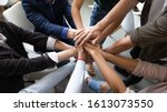 Small photo of Top close up lot of hands stacked together as symbol concept of teambuilding, loyalty, amity and warm relations between office workers seminar participants, business success celebration, start of work