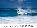 Surfer Riding On A Large Wave...