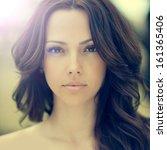 beautiful woman face closeup | Shutterstock . vector #161365406