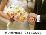 bride and groom holding hands | Shutterstock . vector #161412218