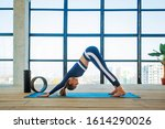 Yoga asana indoor before a...