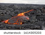 Small photo of Hot magma of an active lava flow emerges from a fissure, the heat of the glowing lava makes the air flicker, the lava cools down slowly and solidifies - Hawaii, Big Island, Kilauea volcano, Kalapana