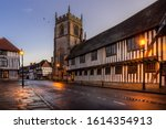 Small photo of Stratford upon Avon, Guildhall and chapel with church. Street lights shine on timber framed buildings