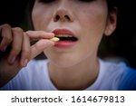 close up of woman putting pill... | Shutterstock . vector #1614679813