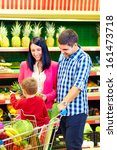 family buying healthy food in supermarket - stock photo