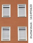 brown facade with closed windows | Shutterstock . vector #161493620