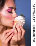 caucasian girl eat cupcake. was ...   Shutterstock . vector #1614961960