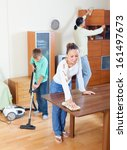 parents with son dusting... | Shutterstock . vector #161497673