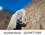 A Religious Jewish Man Wearing...