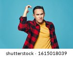 Small photo of funny emotional male plaid shirt grimace Studio