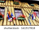 MIREPOIX,FRANCE-SEPTEMBER 30:Front of the town hall of Mirepoix in Ariege, France.With French flags and sign of the town hall,September 30,2013 Mirepoix,France - stock photo