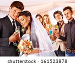 happy wedding couple drinking... | Shutterstock . vector #161523878