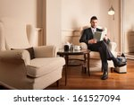 young businessman relaxing...   Shutterstock . vector #161527094