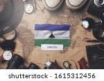 lesotho flag between traveler's ... | Shutterstock . vector #1615312456