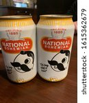 Small photo of Baltimore, MD / US - October 13, 2019: Two unopened ice cold cans of Natty Boh National Bohemian oh boy what a beer on a bar counter top