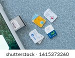 Small photo of Washington, DC / US - December 24, 2019: Collection of international prepaid data network world wide business traveler influence cell micro SIM card tray insert unlocked iPhone carrier luxury plan